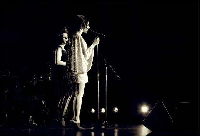 Katie performing with Tina Arena